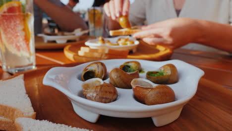 A-man-eats-an-exquisite-dish-of-snails-1