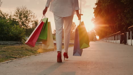 A-woman-in-red-shoes-carries-shopping-bags