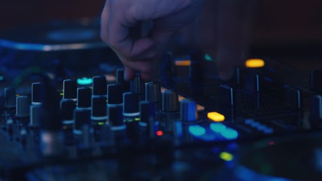DJ-works-at-the-remote-control-at-the-disco-1