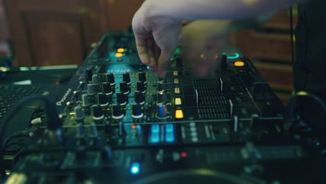 DJ-works-at-the-remote-control-at-the-disco-2