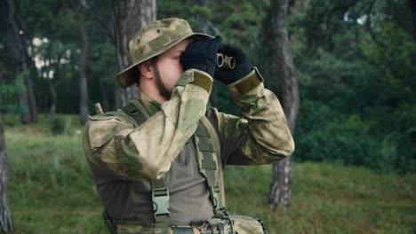 A-soldier-looks-through-binoculars-1