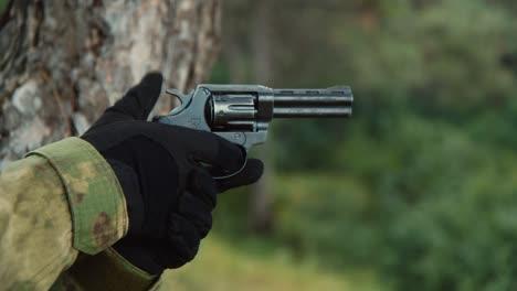Man-shoots-a-revolver-close-up