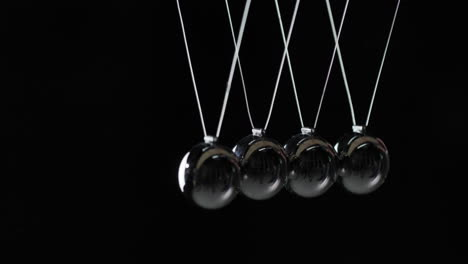 Balls-In-Newton-s-Cradle-Hit-Each-Other-Demonstrating-Energy-Conservation-Law-1