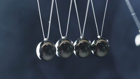 Close-Up-Of-Newton-s-Cradle---Metal-Balls-Hit-One-Another-And-Show-Energy-Conservation-Effect