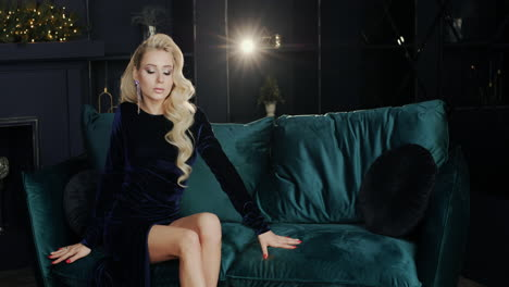 Stylish-blonde-poses-for-the-camera-sitting-on-the-couch-1