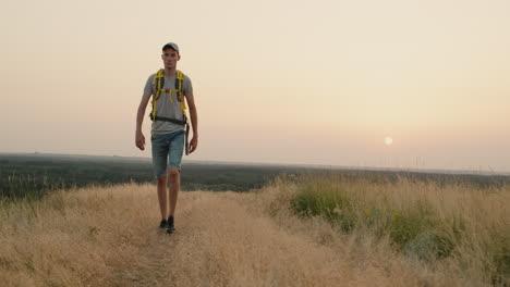 Person-Walking-On-A-Field-Road