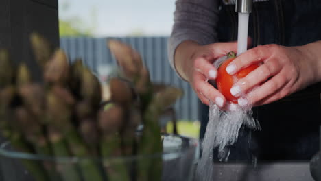 Woman-washes-ingredients-for-salad-2