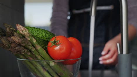Woman-washes-ingredients-for-salad-4