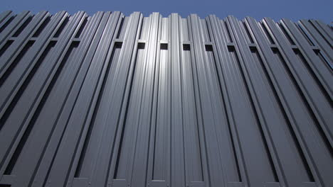 A-fence-made-of-grey-metal-1