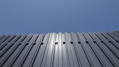 Grey-metal-fence-against-blue-sky-2