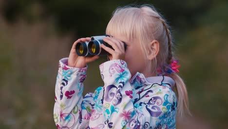 A-cheerful-child-looks-through-binoculars-1