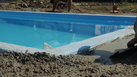 Concrete-flows-down-the-gutters-where-workers-make-paving-1
