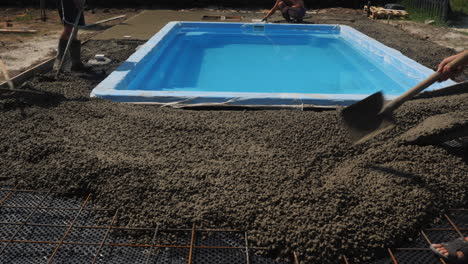 Concrete-flows-down-the-gutters-where-workers-make-paving-2