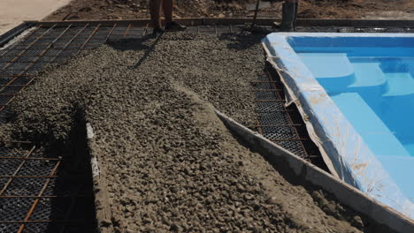 Concrete-flows-down-the-gutters-where-workers-make-paving-3