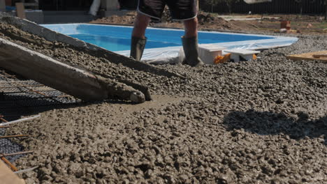 Concrete-flows-down-the-gutters-where-workers-make-paving-4