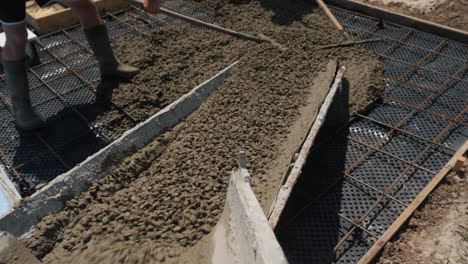 Concrete-flows-down-the-gutters-where-workers-make-paving-5