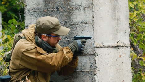 A-man-plays-airsoft-with-a-pistol-in-his-hand