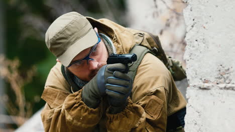 A-man-plays-airsoft-with-a-pistol-in-his-hand-2