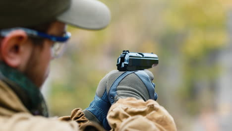 A-man-plays-airsoft-with-a-pistol-in-his-hand-3