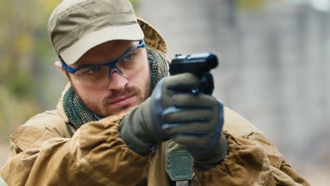 A-man-plays-airsoft-with-a-pistol-in-his-hand-5