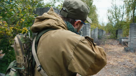 A-man-plays-airsoft-with-a-pistol-in-his-hand-8
