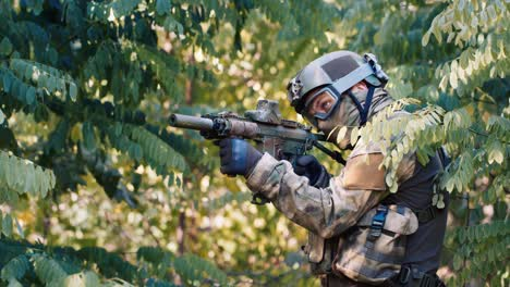 An-airsoft-player-is-hiding-in-a-thicket-of-trees