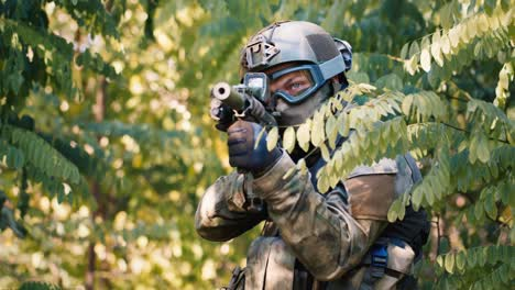 An-airsoft-player-is-hiding-in-a-thicket-of-trees-1