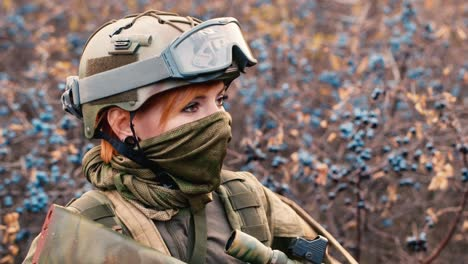 A-woman-in-camouflage-aims-with-a-rifle-1