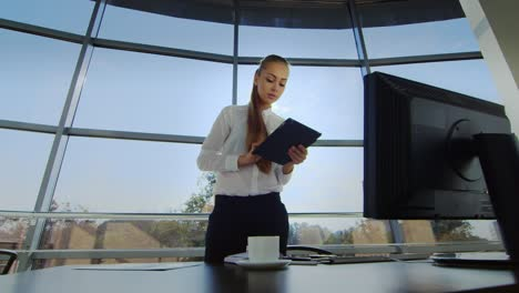 A-woman-in-a-business-bone-works-in-a-spacious-office