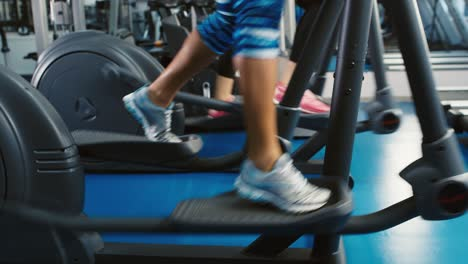 Women-s-legs-on-an-exercise-bike-close-up