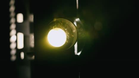 Close-up-of-vintage-projector-light-flickering-in-the-dark