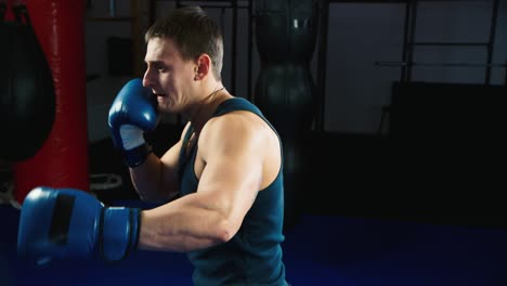 A-young-boxer-practices-punches-on-a-punching-bag-1
