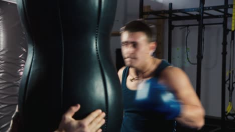 A-young-boxer-practices-punches-on-a-punching-bag-3
