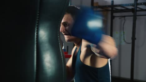 A-young-boxer-practices-punches-on-a-punching-bag-4
