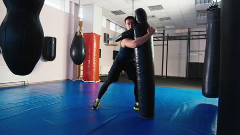 A-young-boxer-practices-punches-on-a-punching-bag-5