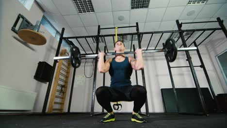 Athlete-trains-with-a-barbell-in-the-gym