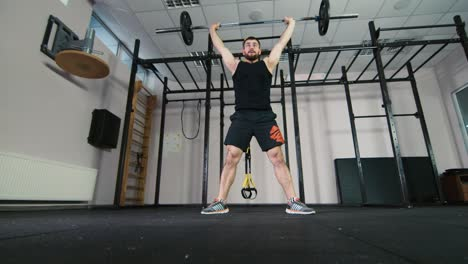 Athlete-trains-with-a-barbell-in-the-gym-1