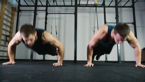 Two-athletes-do-strength-exercises-in-the-gym-1