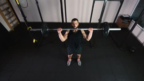 Athlete-does-exercises-in-the-gym-3