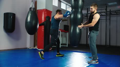 A-young-boxer-practices-punches-on-a-punching-bag-7