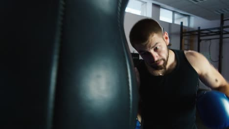 A-young-boxer-practices-punches-on-a-punching-bag-9