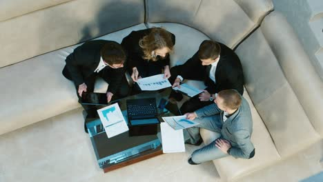 A-group-of-businessmen-goes-into-the-lobby-of-the-hotel