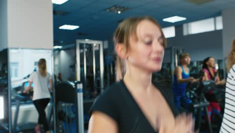 A-woman-trains-in-the-gym-with-a-trainer-1