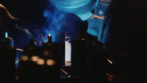 A-welder-in-a-protective-helmet-and-clothes-welds-as-sparks-fly-1