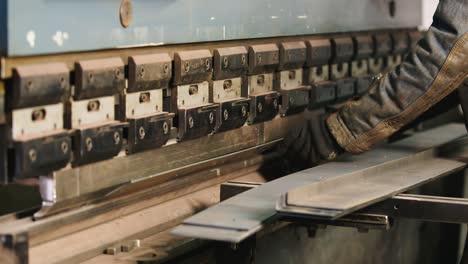 Worker-puts-a-metal-workpiece-in-a-machine