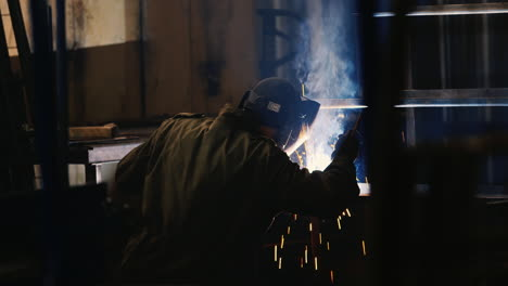 A-welder-in-a-protective-helmet-and-clothes-welds-as-sparks-fly-7