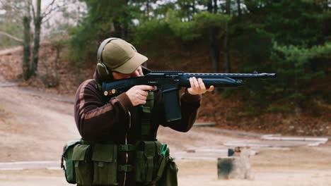 A-hunter-with-headphones-shoots-a-gun