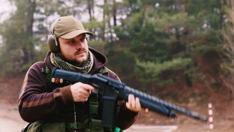 A-hunter-with-headphones-shoots-a-gun-1
