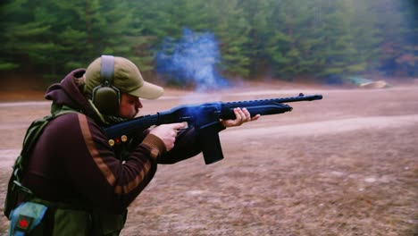 A-hunter-with-headphones-shoots-a-gun-6