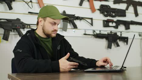 Man-behind-a-counter-in-an-arms-store